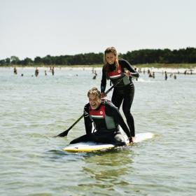 A couple stand up paddling on Bornholm
