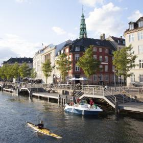 Copenhagen Canal with boats sailing and buildings