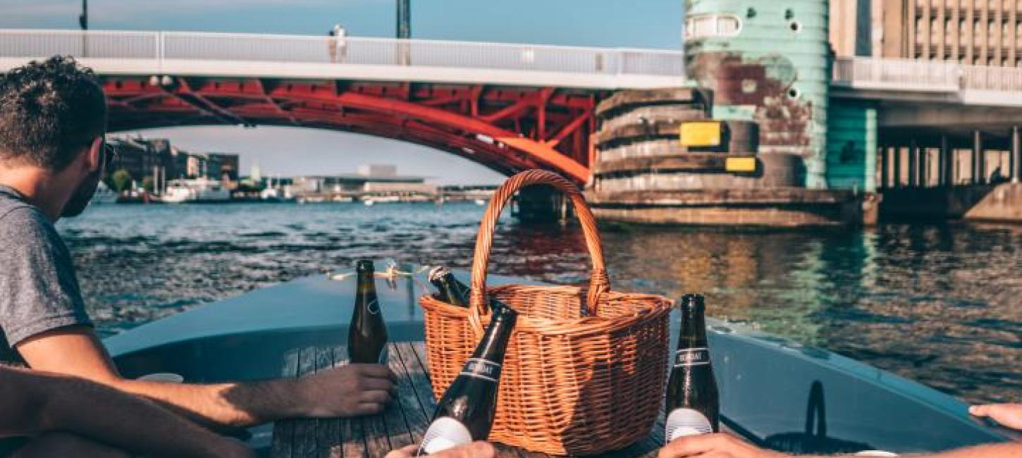 Have a picnic while cruising around in Copenhagen's harbour