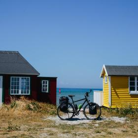 A stop by the beach cabins on Ærø while cycling the Baltic Sea Cycling Route in Denmark